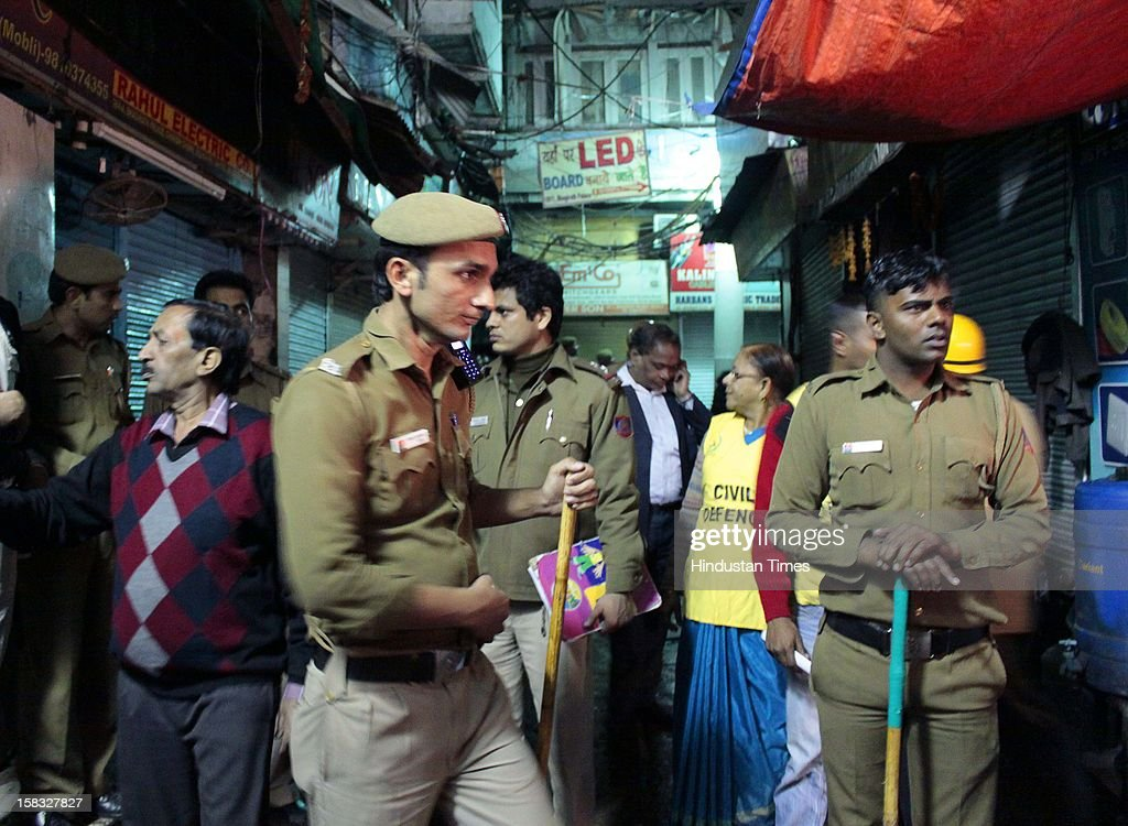 Police personnels are at site of fire at a godown in Bhagirath Palace, an electrical market of Chandni Chowk area, on December 13, 2012 in New Delhi, India. The blaze erupted at Bhagirath Palace market at around 5.10 pm and 22 fire tenders were immediately rushed to the spot. The fire is doused with no casualties reported.