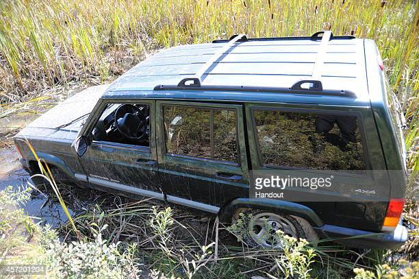A police photo shows a Jeep that ambush suspect Eric Frein is believed to have driven into a swampy area and abandoned after the Sept 12 shooting in...