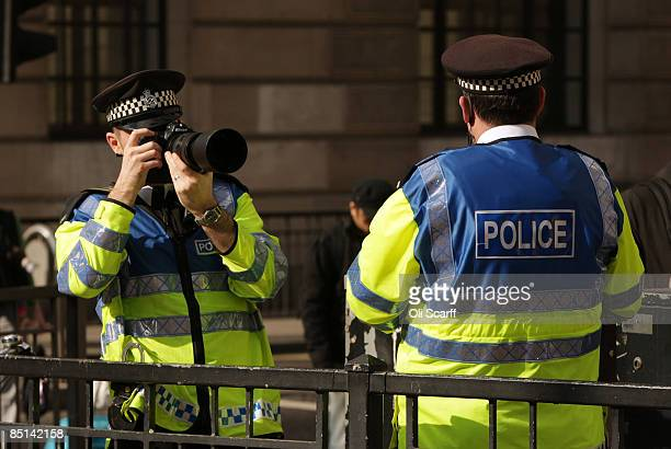 Police photograph protesters for 'Stop Huntingdon Animal Cruelty' as they gather in front of the Bank of England on February 27 2009 in London The...