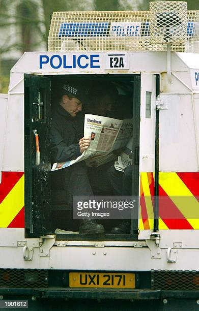 Police pictured the streets outside Hillsborough Castle April 7 2003 where US President George Bush will be meeting British Prime Minister Tony Blair...