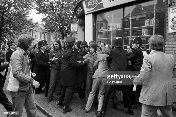 Police pile into a crowd of struggling pickets outside strike hiy Grunwick factory in Willesden