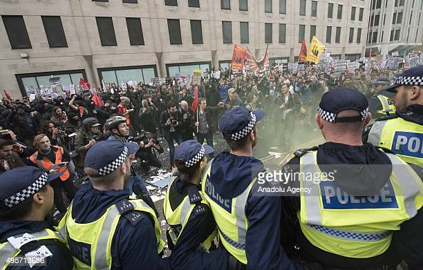 Police police block the protesters as thousands of students gathering in central London on to protest the government over tuition fees and plans by...