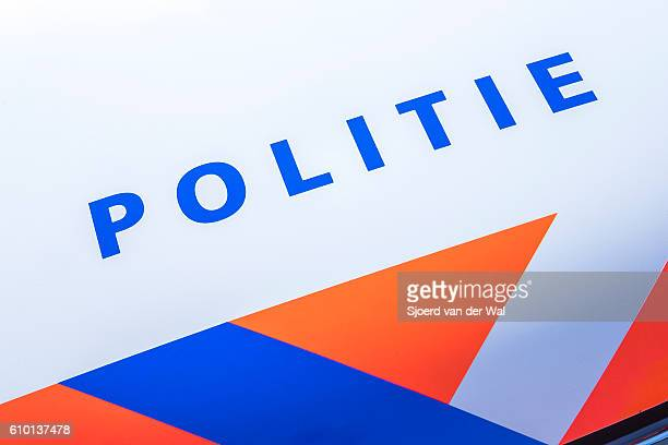 Police - Politie in Dutch on a police car front