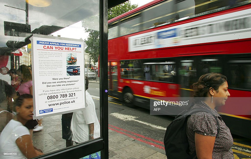 A police poster appealing for witnesses to the London bombings is placed on a bus shelter outside Kings Cross Station in London 18 July 2005 AFP...