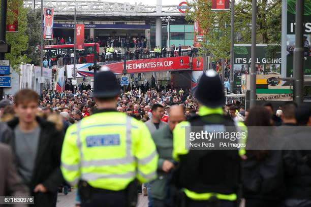Police presence as fans arrive for the Emirates FA Cup Semi Final match at Wembley Stadium London