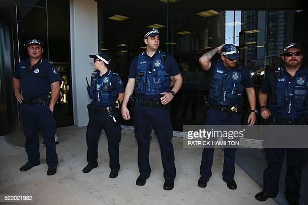 A police presence is seen outside the courthouse before the arrival of US actor Johnny Depp and his wife Amber Heard in the Gold Coast on April 18...