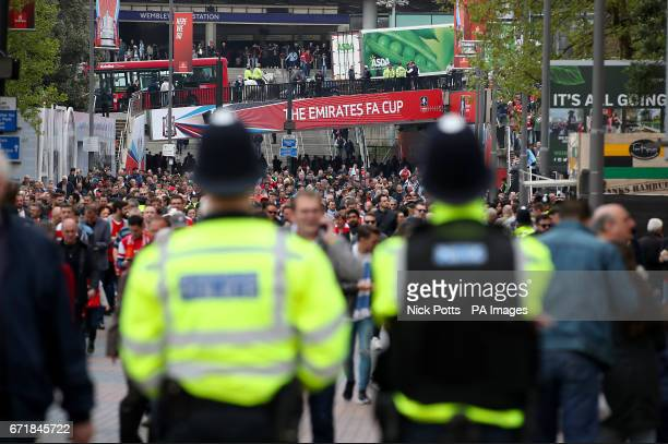 Police presence on Wembley Way prior to the Emirates FA Cup Semi Final match at Wembley Stadium London