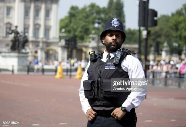 Police presence outside Buckingham Palace ahead of the departure of Britain's Queen Elizabeth II to the Houses of Parliament to address the State...