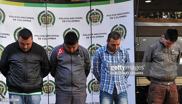 Police present to the press four suspects in the killing of US Drug Enforcement Agency agent James 'Terry' Watson who was stabbed to death during a...