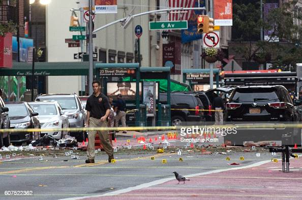 Police process the crime scene of remnants of bomb debris following an explosion on 23rd St in Manhattan's Chelsea neighborhood on September 18 2016...
