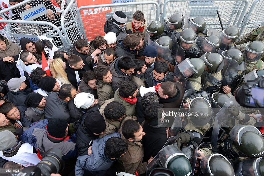 Police push back hundreds of protesters trying to enter a courthouse in Silivri near Istanbul on December 13, 2012 where prosecutors are scheduled to deliver their final arguments in the case against 275 people accused of plotting to overturn the Islamic-leaning government. A verdict in the four-year long case involving 275 defendants, including Turkey's former military chief Ilker Basbug and other army officers as well as lawyers, academics and journalists, is expected in the coming weeks. The defendants face dozens of charges, ranging from membership in an underground 'terrorist organisation' known as Ergenekon and instigating an armed uprising against Erdogan and his Justice and Development Party (AKP), which came to power in 2002.