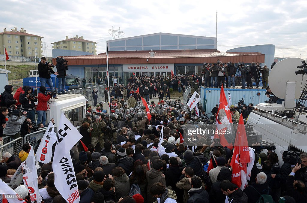 Police push back hundreds of protesters trying to enter a courthouse in Silivri near Istanbul on December 13, 2012, where prosecutors are scheduled to deliver their final arguments in the case against 275 people accused of plotting to overturn the Islamic-leaning government. A verdict in the four-year long case involving 275 defendants, including Turkey's former military chief Ilker Basbug and other army officers as well as lawyers, academics and journalists, is expected in the coming weeks. The defendants face dozens of charges, ranging from membership in an underground 'terrorist organisation' known as Ergenekon and instigating an armed uprising against Erdogan and his Justice and Development Party (AKP), which came to power in 2002.