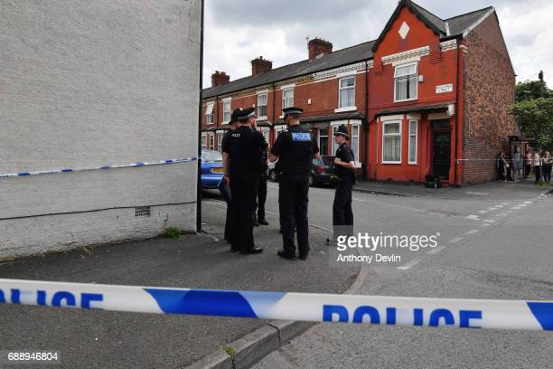 Police put up a corden as they attend the scene of a raid in the Moss Side area as part of their ongoing investigation following the terror attack...
