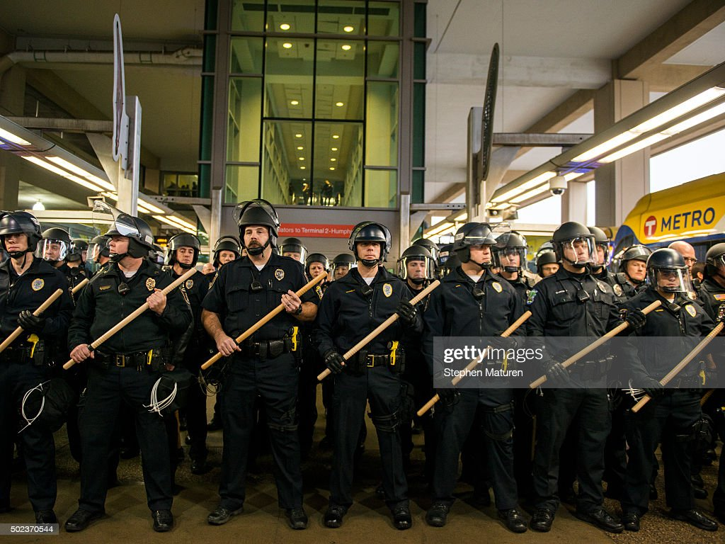 Police queue up at the Minneapolis-St. Paul International airport Lightrail stop, where a number of Black Lives Matter protestors attempted to enter the airport on December 23, 2015 in Minneapolis, Minnesota. Black Lives Matter Minneapolis staged a brief protest at the Mall of America in Bloomington, MN before moving their protest to the airport. (Photo by Stephen Maturen/Getty Images))