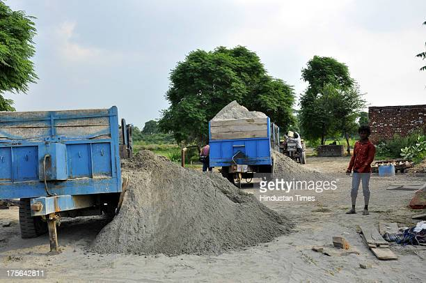 Police raided the Pychara village and punctured the tyres of trolleys and trucks filled with sand on August 3 2013 in Ghaziabad India After Gautam...