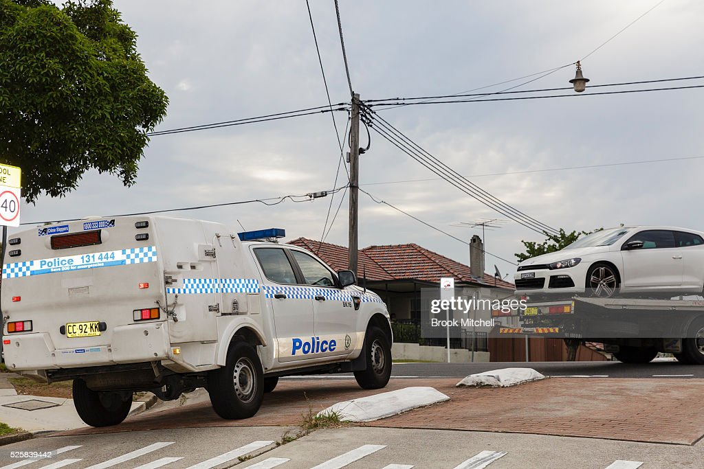 Police recover one of two cars involved at the Bankstown Central Shopping Centre shooting on April 29, 2016 in Sydney, Australia. Cooeeyama Parade, Greenacre. One man has been confirmed dead, with two others injured.