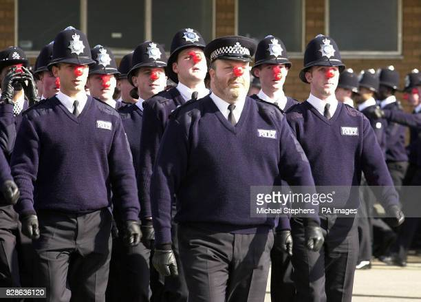 Police recruits wearing red noses in a rehearsal for their passing out parade at Hendon Training School North London The new recruits have undertaken...