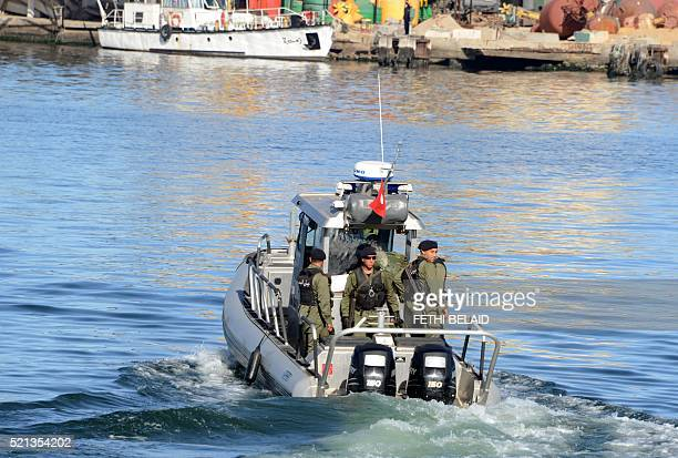 Police reinforcments take a boat to the island of Kerkennah after residents of Sfax blocked access to a ferry on April 15 2016 in an attempt to...