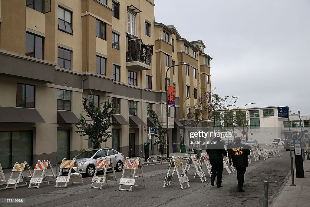 Police remain at the scene of a balcony collapse at an apartment building near UC Berkeley on June 16 2015 in Berkeley California 5 people were...