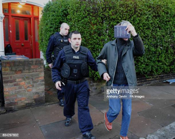 Police remove a man from an address in Upper Tollington Finsbury Park during a dawn raid as part of Operation Mista
