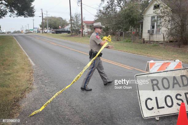 Police remove a road block as they begin to wrap up their investigation of the shooting at the First Baptist Church of Sutherland Springs on November...