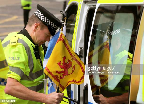 Police remove Alan Smart's belongings after he was led away by police after performing with his guitar with anti bedroom tax protesters outside the...