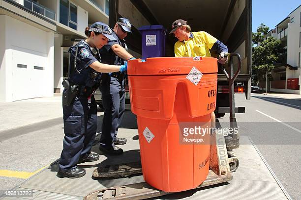 Police remove hazardous material from an apartment on Commercial Road Teneriffe in Brisbane Queensland during a murdersuicide investigation Chef...