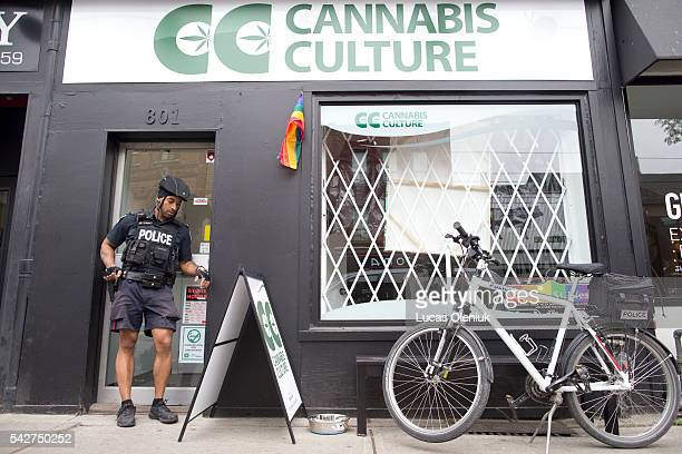 Police removed marijuana and cannabis oil following a raid where three people were arrested at Cannabis Culture on Queen Street West in Toronto...