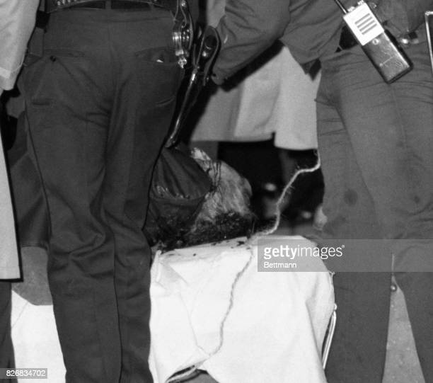 Police removed the bloodcovered body of reputed Boss of Bosses Paul C 'Big Paul' Castellano from the crime scene after he and his driver were gunned...
