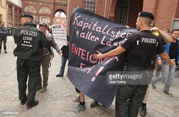 Police restrain anticapitalist demonstrators outside the BMW Guggenheim Lab in Prenzlauer Berg district on the first day it was open to the public on...