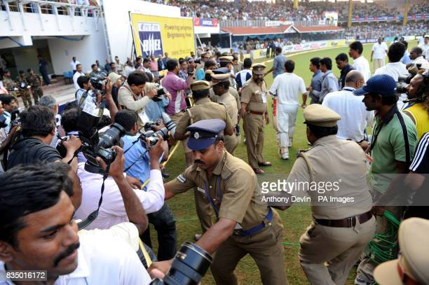 Police restrain media following India's victory in the first test match