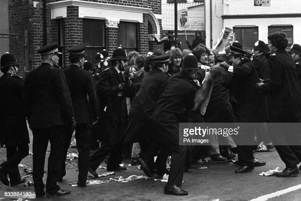 Police restrain pickets as scuffles break out at Grunwick factory as week long mass picket gets under way The official strike is in its 10th month