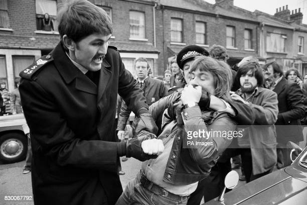Police restraining pickets outside the Grunwick Processing Laboratories at Willesden London who are supporting an official strike by process workers