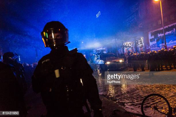 A police riot team work through the crowds during the 'Welcome to Hell' antiG20 protest march on July 6 2017 in Hamburg Germany Leaders of the G20...