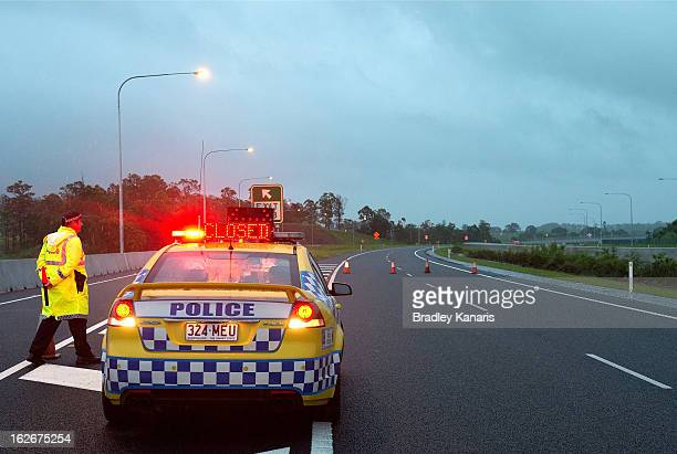 Police road block on the Bruce Highway south of Gympie blocks traffic heading into the town on February 26 2013 in Gympie Australia Gympie residents...