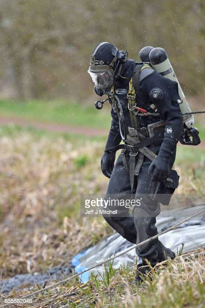Police Scotland diver searches a canal stretch for an eleven year old schoolgirl Moira Anderson on March 20 2017 in Coatbridge Scotland Police are...