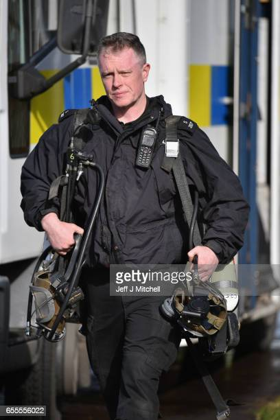 Police Scotland diver walks to search a canal stretch for an eleven year old schoolgirl Moira Anderson on March 20 2017 in Coatbridge Scotland Police...