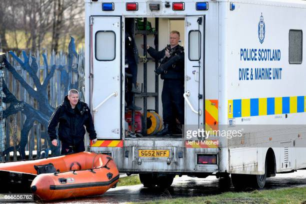 Police Scotland divers move equipment to search a canal stretch for an eleven year old schoolgirl Moira Anderson on March 20 2017 in Coatbridge...