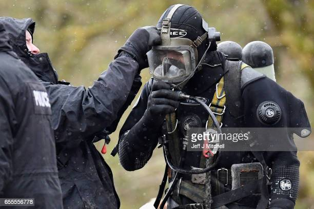 Police Scotland divers prepare their diving equipment as they search a canal stretch for an eleven year old schoolgirl Moira Anderson on March 20...