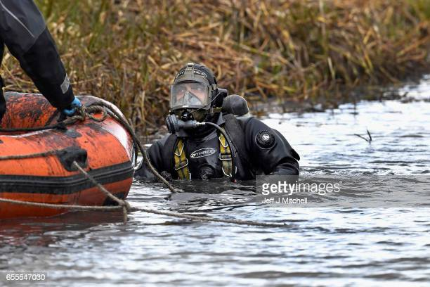 Police Scotland divers search a canal stretch for an eleven year old schoolgirl Moira Anderson on March 20 2017 in Coatbridge Scotland Police are...