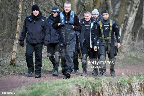 Police Scotland divers walk to search a canal stretch for an eleven year old schoolgirl Moira Anderson on March 20 2017 in Coatbridge Scotland Police...