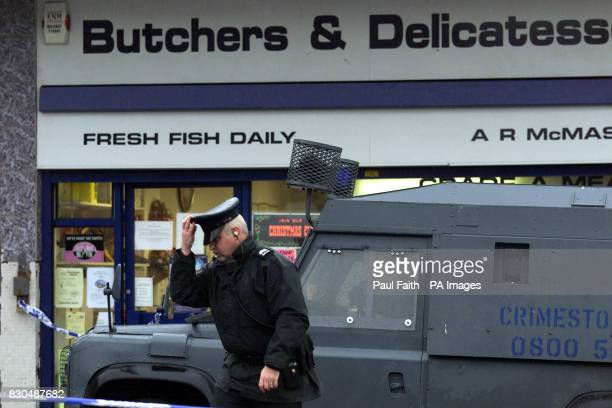 Police seal off a butcher's shop in North Belfast after a man was shot in the chest by a gunman as he worked in the shop It is belived the shooting...