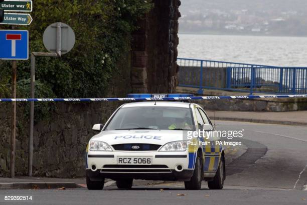 Police seal off an area in Holywood Co Down after a police officer was discovered lying in the middle in the middle of the road overnight He is...