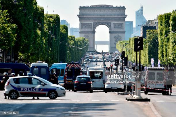 Police seal off the ChampsElysees avenue on June 19 2017 in Paris after a car crashed into a police van before bursting into flames with the driver...