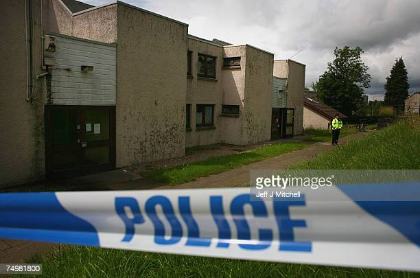Police seal off the doctors accommodation at Royal Alexandra Hospital June 2 2007 in Glasgow Scotland Police have arrested a further two men in the...