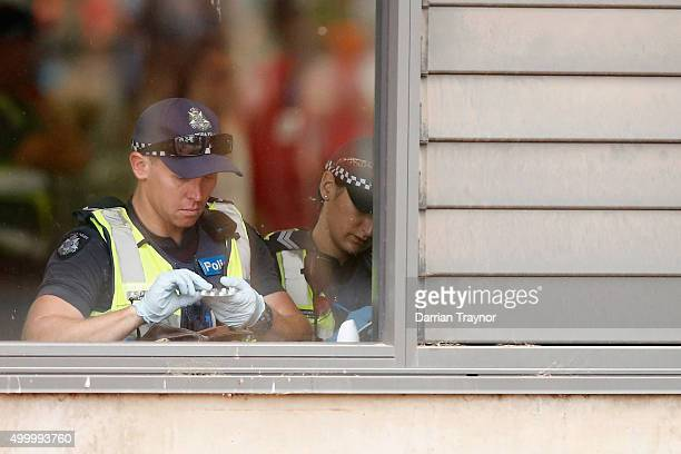 Police search a detained patrons bag before entry into the Sterio Sonic music festival at Melbourne Showgrounds on December 5 2015 in Melbourne...