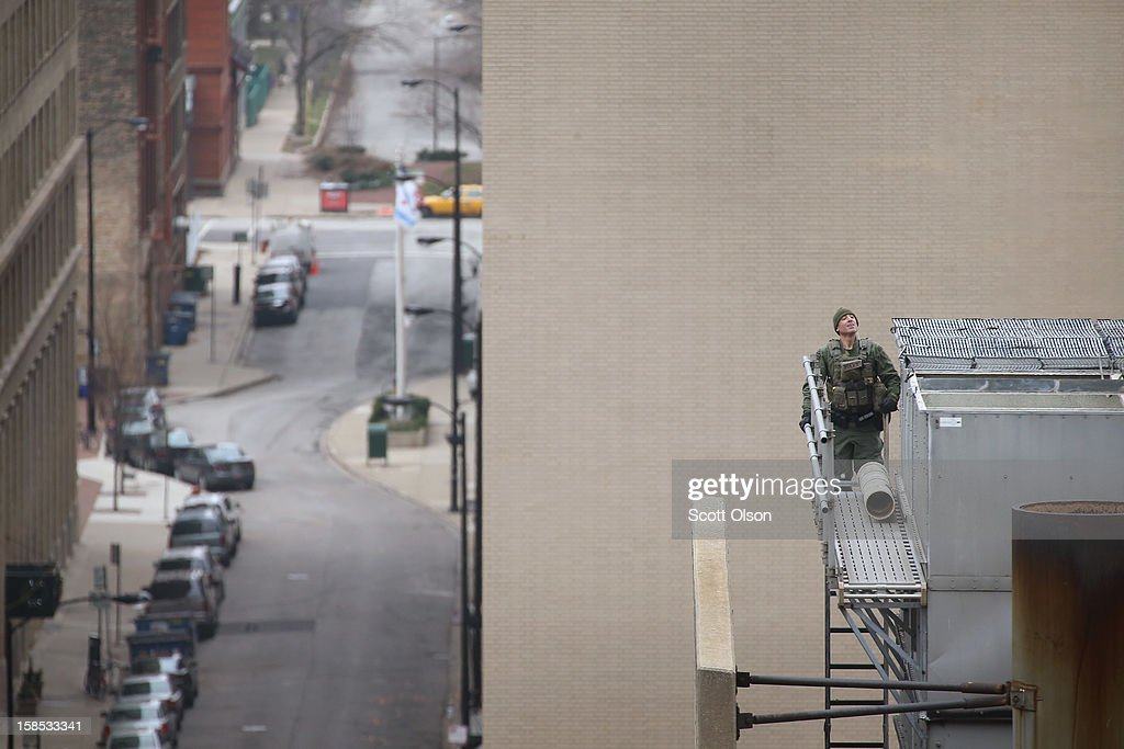 Police search a parking structure attached to the federal Metropolitan Correctional Center in the Loop after two convicted bank robbers escaped on December 18, 2012 in Chicago, Illinois. Joseph 'Jose' Banks and Ken Conley appear to have busted away concrete to enlarge a window opening then climbed down about 16 stories on makeshift ropes on the outside of the building. Banks, known as the Second-Hand Bandit, was convicted last week of two bank robberies and two attempted robberies where he made off with a nearly $600,000, $500,000 of which is still unaccounted for. Conley was convicted of robbing nearly $4,000 from a bank last year.