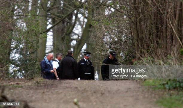 Police search a wooded area near to Redington Road Woolton Liverpool where the bodies of a man and woman believed to be in their late 50s or early...