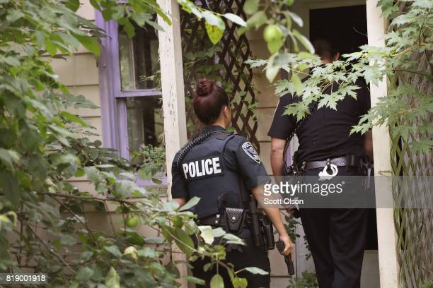 Police search an abandoned home after neighbors reported seeing several people enter the home on July 12 2017 in Rockford Illinois Police claim that...