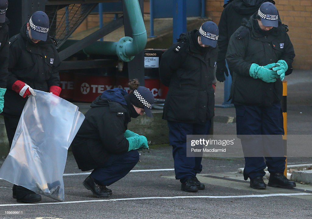 Police search an area near the scene of a helicopter crash on January 17, 2013 in London, England. Police cordons have remained in place as investigations continue into the cause of yesterday's helicopter crash in which two people died.